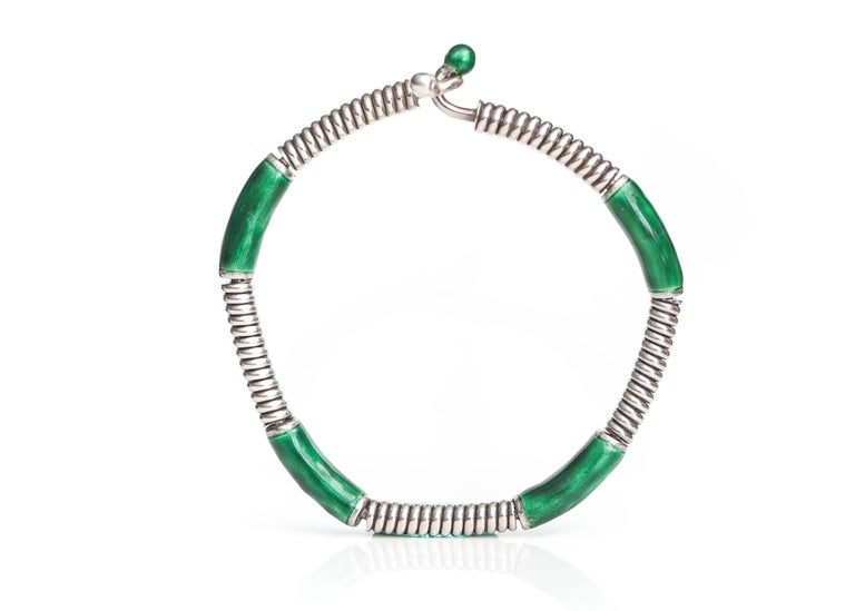 Gucci Sterling Silver, Green Enamel Bangle Cuff Bracelet  Features 4 Sterling Silver Wire Coil segments alternating with 4 Green Glossy Enamel segments. The bracelet ends with one Sterling Silver sphere and one Green Enamel sphere. The ends of the