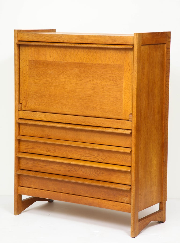 France 1960s solid French oak, formica finish tray on desk, leather straps 4 drawers in good vintage condition some surface stains, on desk part when unfolded, please see pictures On display at 200 Lexington avenue, NYC Depth when unfolded is