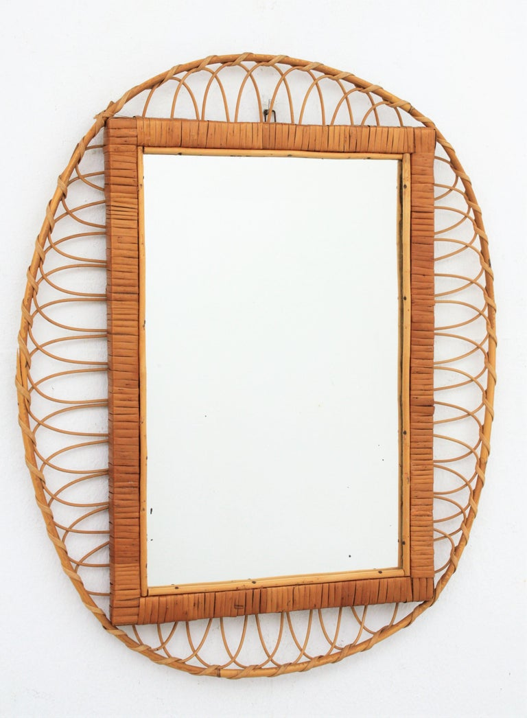 1950s French Mediterranean braided rattan and wicker wall mirror.