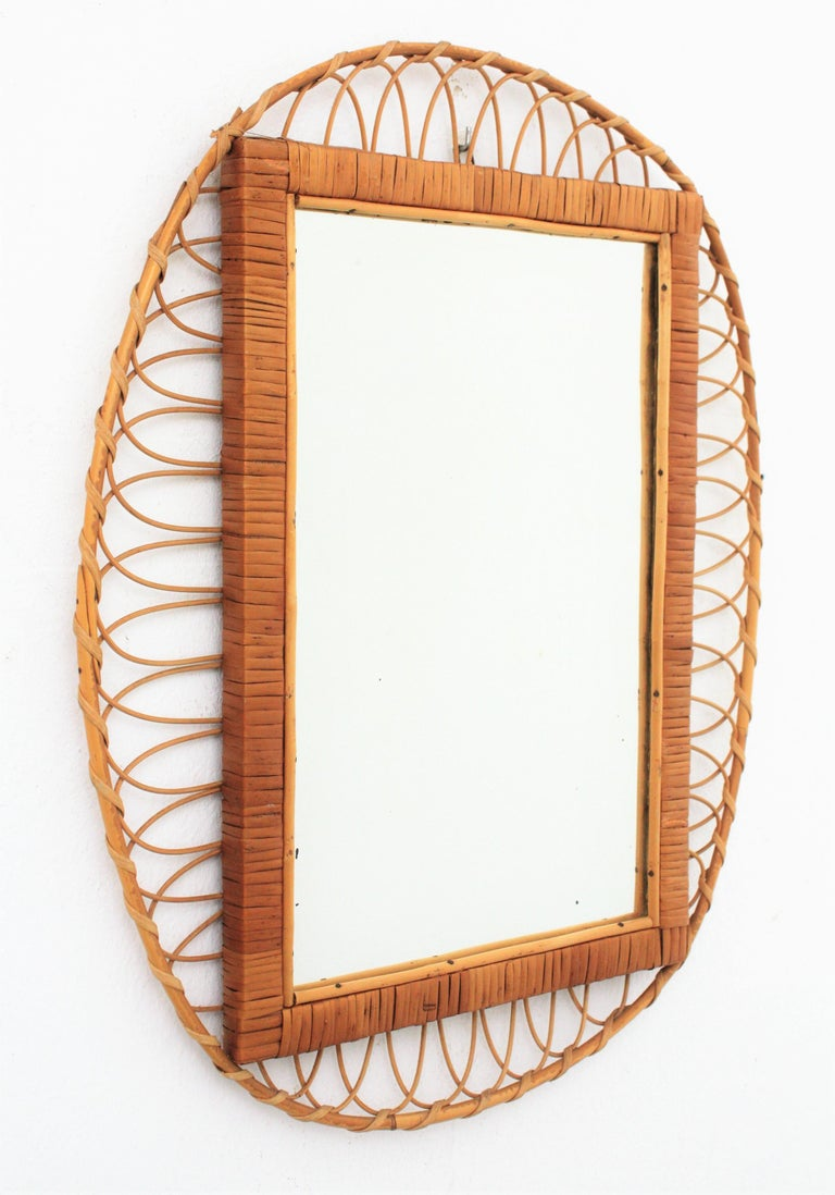 European 1950s Handcrafted French Riviera Rectangular Mirror with Oval Rattan Frame For Sale