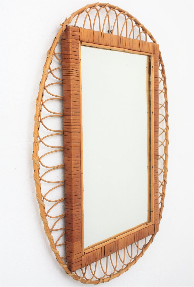 Hand-Crafted 1950s Handcrafted French Riviera Rectangular Mirror with Oval Rattan Frame For Sale