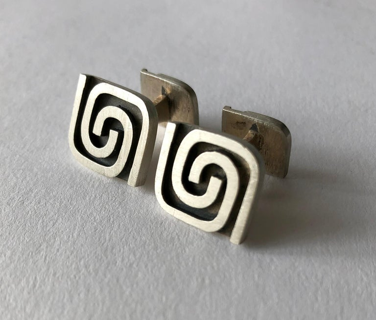 Sterling silver cufflinks created by American modernist jeweler Harold Fithian, circa 1950's.  Cufflinks face measure 5/8