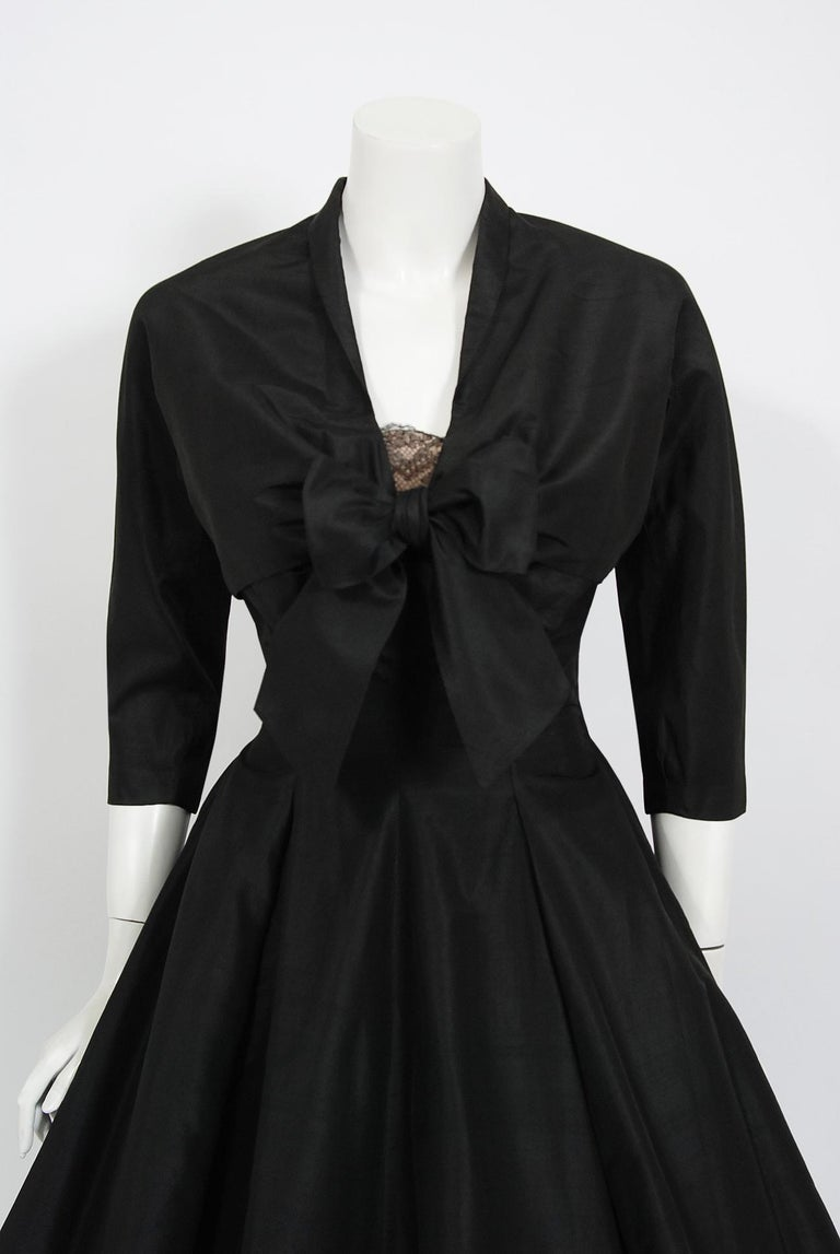 Breathtaking Harvey Berin designer black silk and chantilly lace party dress dating back to the mid 1950's. Harvey Berin opened his business in 1921, and by the 1940's he was an important name in women's fashion. His designer, Karen Stark, adapted