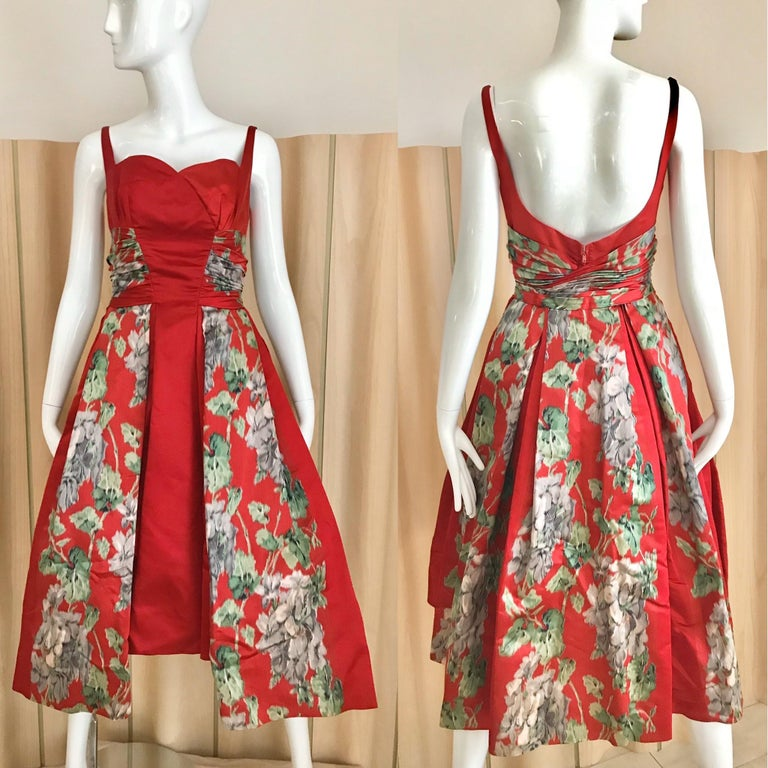 Stunning 1950s Red Silk Satin floral dress from Hattie Carnegie. Dress has built in crinoline. Best fit size 2/ Xs  * Dress has been dry cleaned **For international buyer please contact me directly for shipping please or choose express shipment