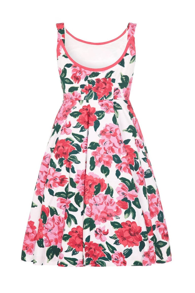 This beautiful 1950s white cotton sundress with pink floral print by respected British label Horrockses is in excellent vintage condition and of superb quality. This classic 1950s sun dress features a scoop neckline trimmed in fuchsia, an attractive