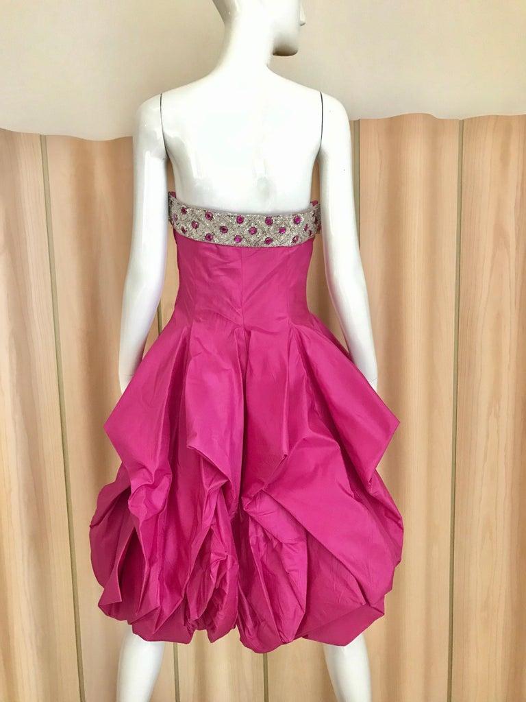 """Vintage 1950s Hot pink silk strapless cocktail dress with beaded bust and peplum hem. Bust: 34 inches / Waist: 29"""" / dress length ; 33"""