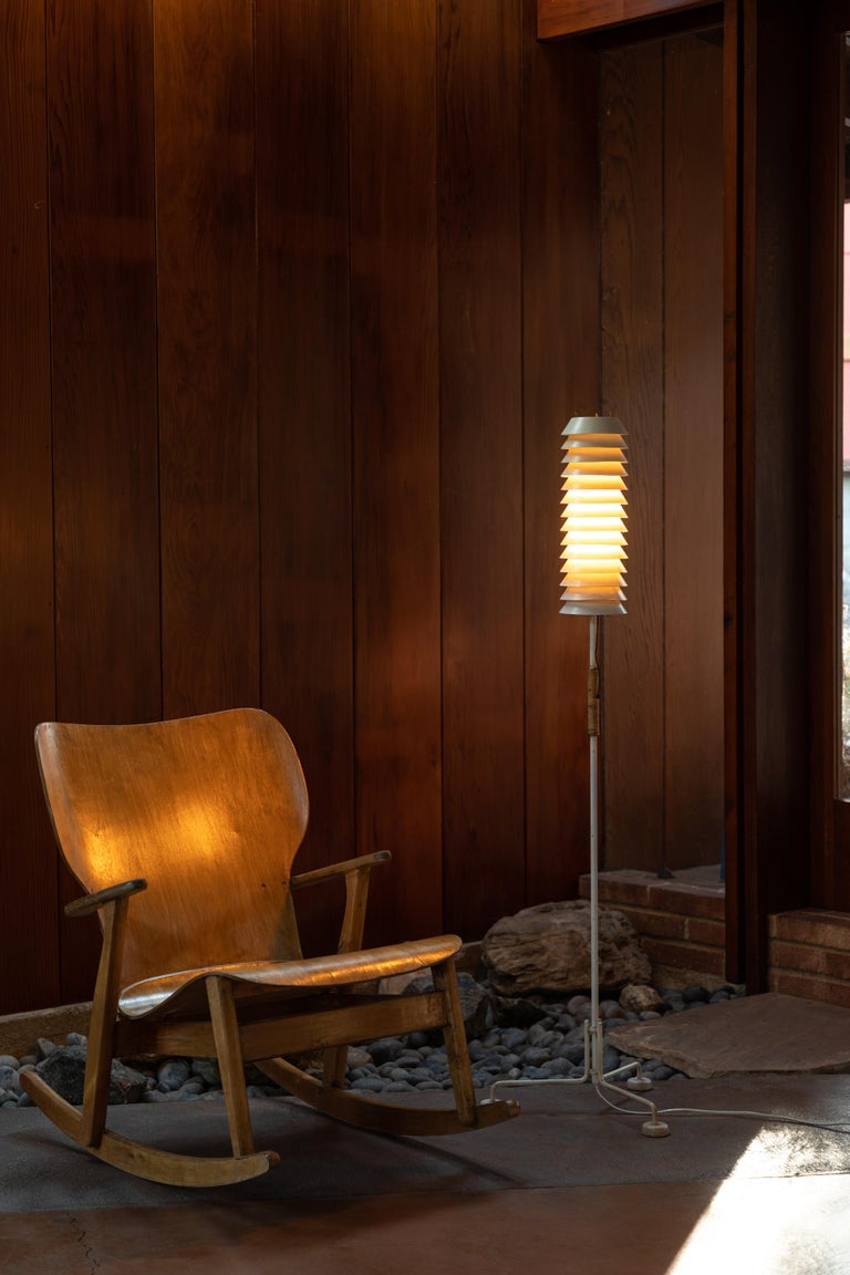 1955, Ilmari Tapiovaara 'Maija' floor lamp for Asko/Hienoterä. A rare original vintage edition made in Finland and executed in painted metal with brass hardware and rattan. This highly refined and sculptural lamp casts beautifully diffused slices of