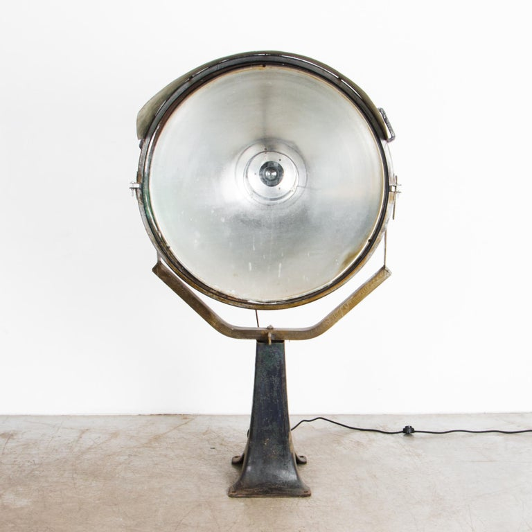 An industrial scale lighting fixture from Czech Republic, circa 1950. Updated and rewired for an interior setting, this lamp was originally used for architectural spotlighting. Beautiful textured patina shows the age, an embedded history of past