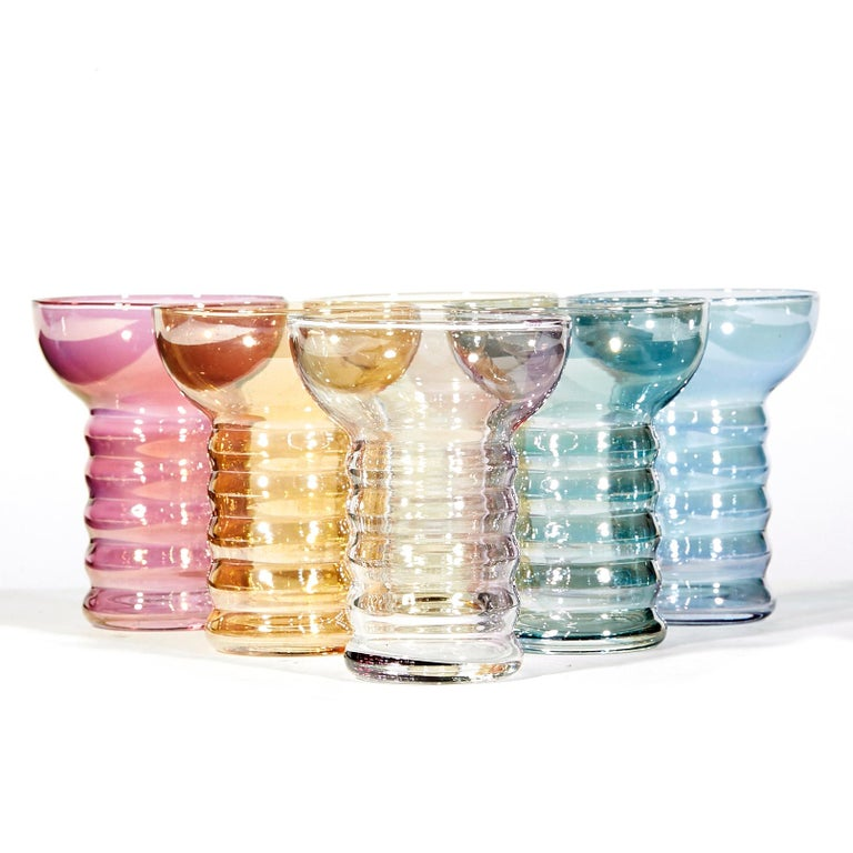 Vintage 1950s set of 7 iridescent multicolored glass beverage set with a handled pitcher and six glass tumblers. No maker's mark. Measures: Tumblers: 3in. Dia x 3.75in H.