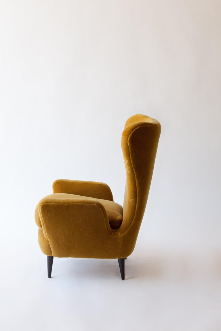 A 1950s Italian armchair attributed to Paolo Buffa newly reupholstered in an ocre wool mohair.