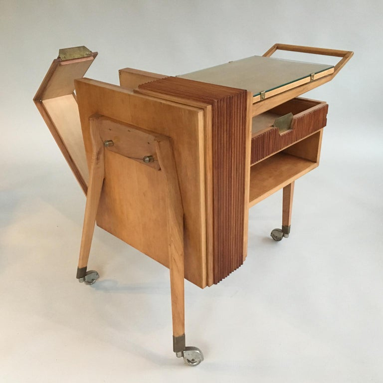 Unusual, sculptural 1950s Italian bar cart or drinks trolley, mid-century modern. The front opens up to store bottles and it has a small drawer underneath.