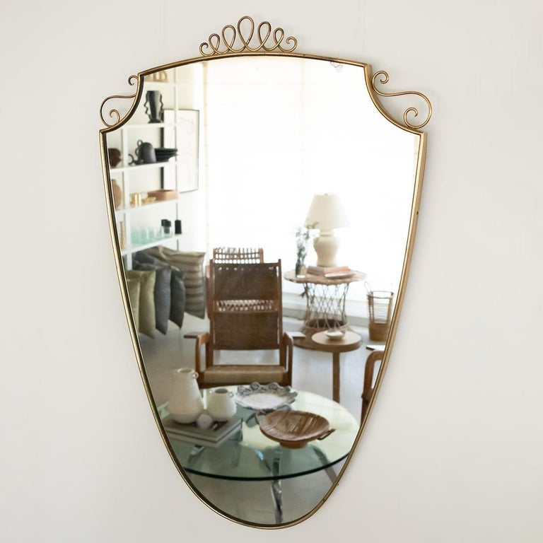 1950s Italian Brass Shield Mirror with Loop Detail In Good Condition For Sale In Los Angeles, CA