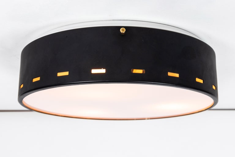 1950s Italian ceiling lamp attributed to Bruno Gatta for Stilnovo. Executed in black painted metal with opaline glass and brass hardware details. A sculptural and refined design characteristic of 1960s Italian design at its highest level.  Not UL