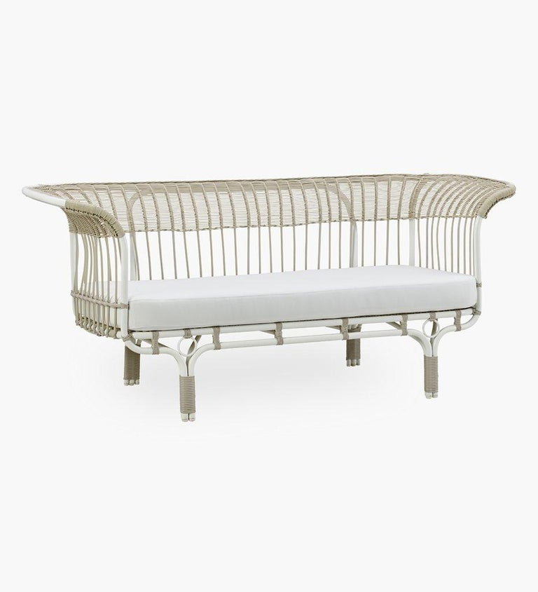 1950s design outdoor sofa by Franco Albini composed of a white lacquer and tubular metal structure, dressed with a light brown resin. High quality, official re-edition, elegant and timeless design.