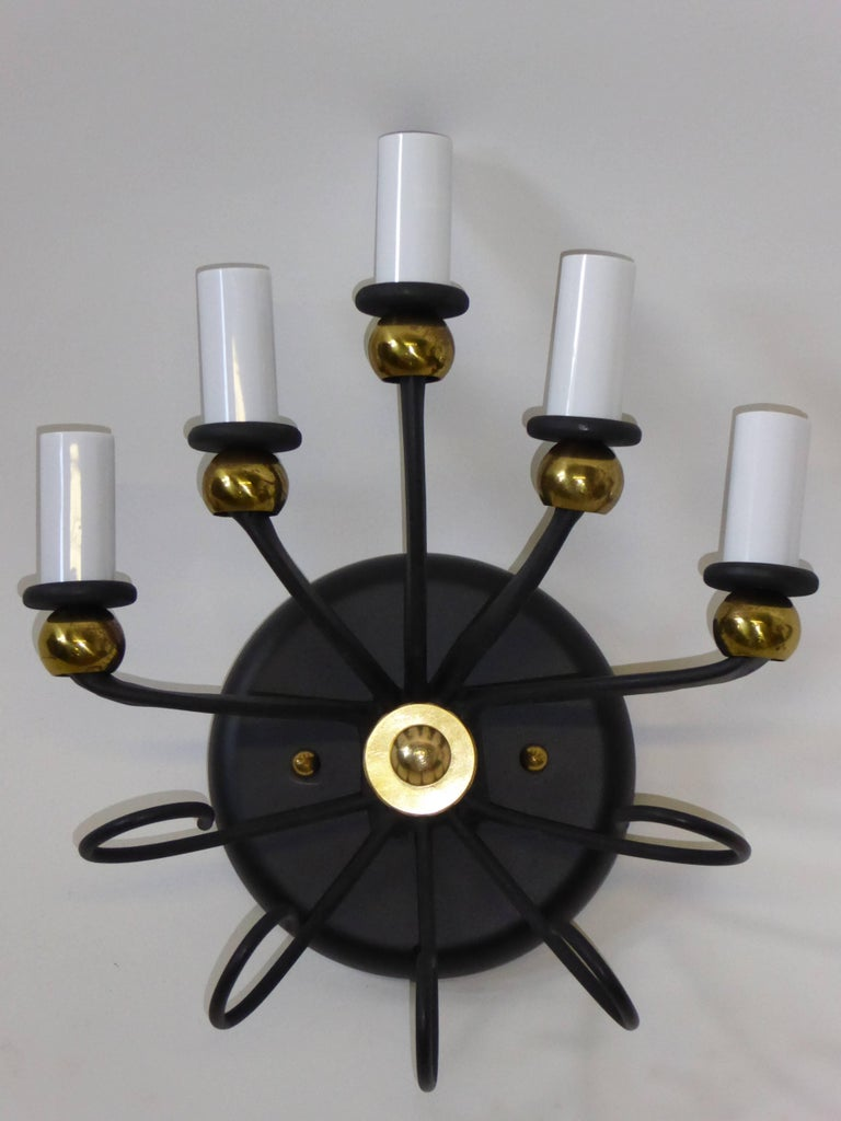 Brass balls and curling black meal highlight this single inspired Italian made applique or sconce. With five candelabra lights and five curling tentacles below, the mix of brass balls and black metalwork is superb 1950s fun. Rewired and with new UL