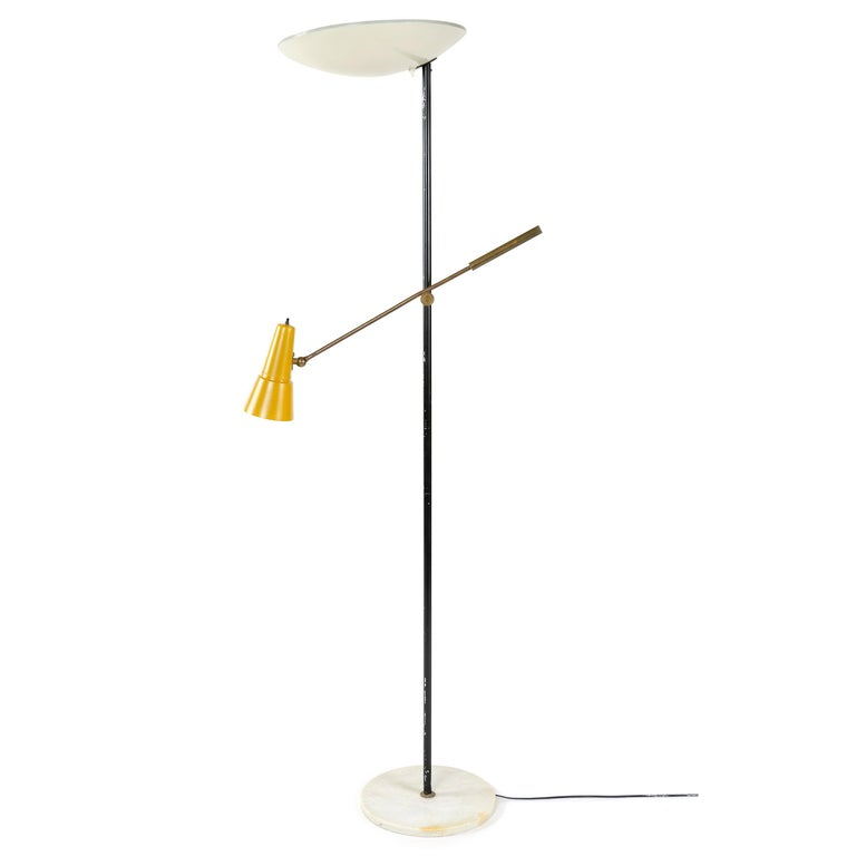 A modernist white, black and golden lacquered steel floor lamp with a round marble base, disc shade, and an adjustable brass arm with a pivoting conical shade. Stamped.
