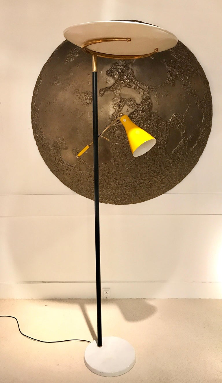 1950s Italian floor lamp by Lumen. Brass details and white marble base Yellow adjustable arm 360 degrees rotating white top shade Vintage condition Rewired.