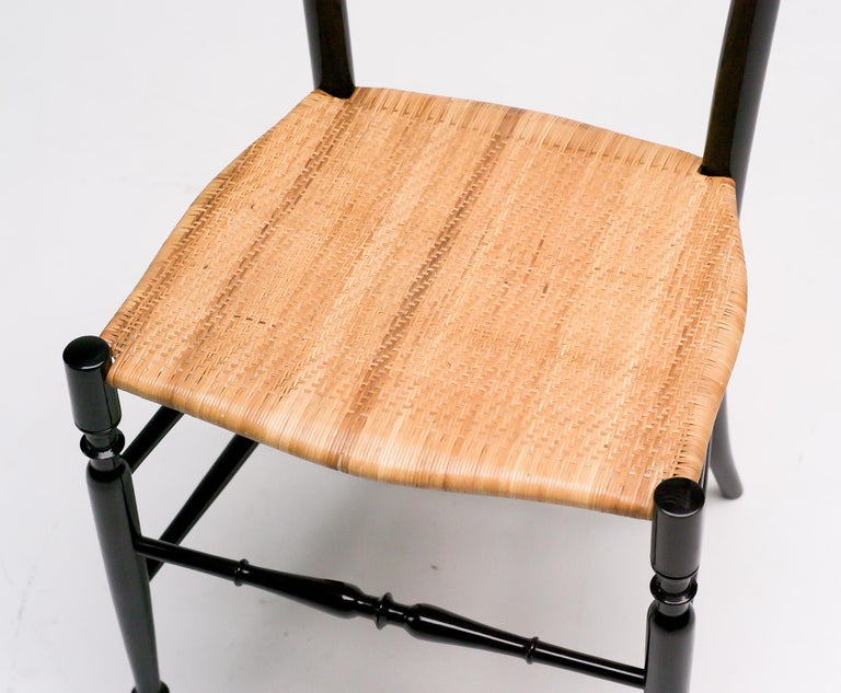 Wonderful sculptural side chair made in Chiavari, Italy, 1950s. Gloss black lacquered maple frame, original cane seat.  High version of the Chiavari chair in very good original condition.