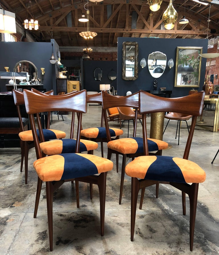 Set of six beech high back dining chairs of the Italian designer Ico Parisi reupholstered in blue and orange fabric.