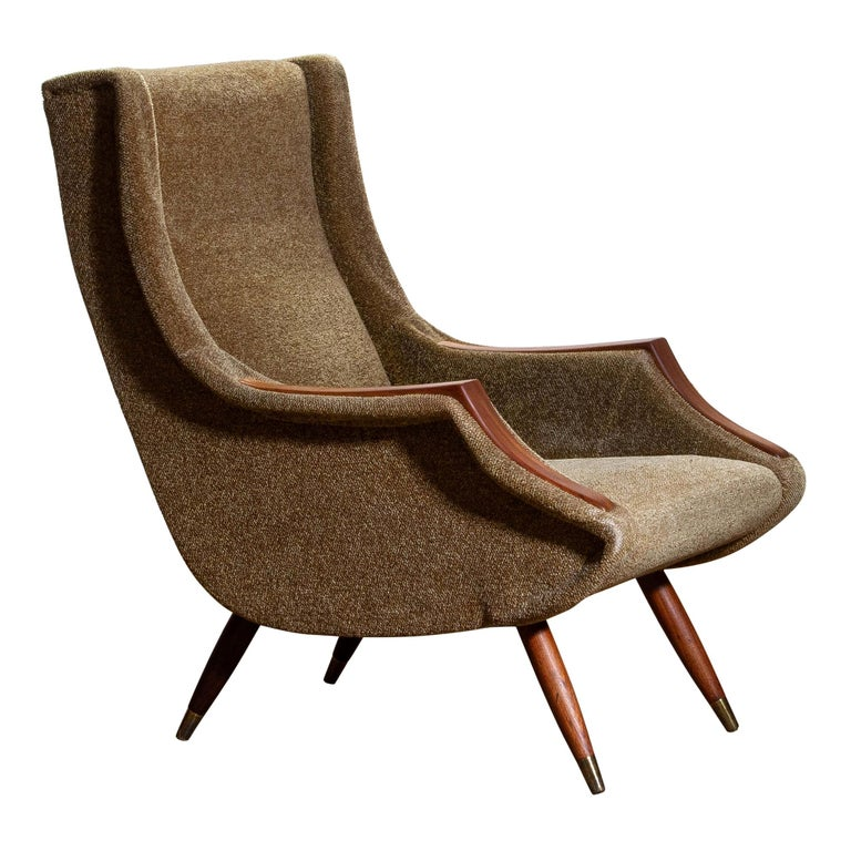 1950s, extremely rare easy chair designed by Aldo Morbelli for Isa Bergamo Italy still in original condition. Armrests and legs in teak. Overall impression for the age is good.