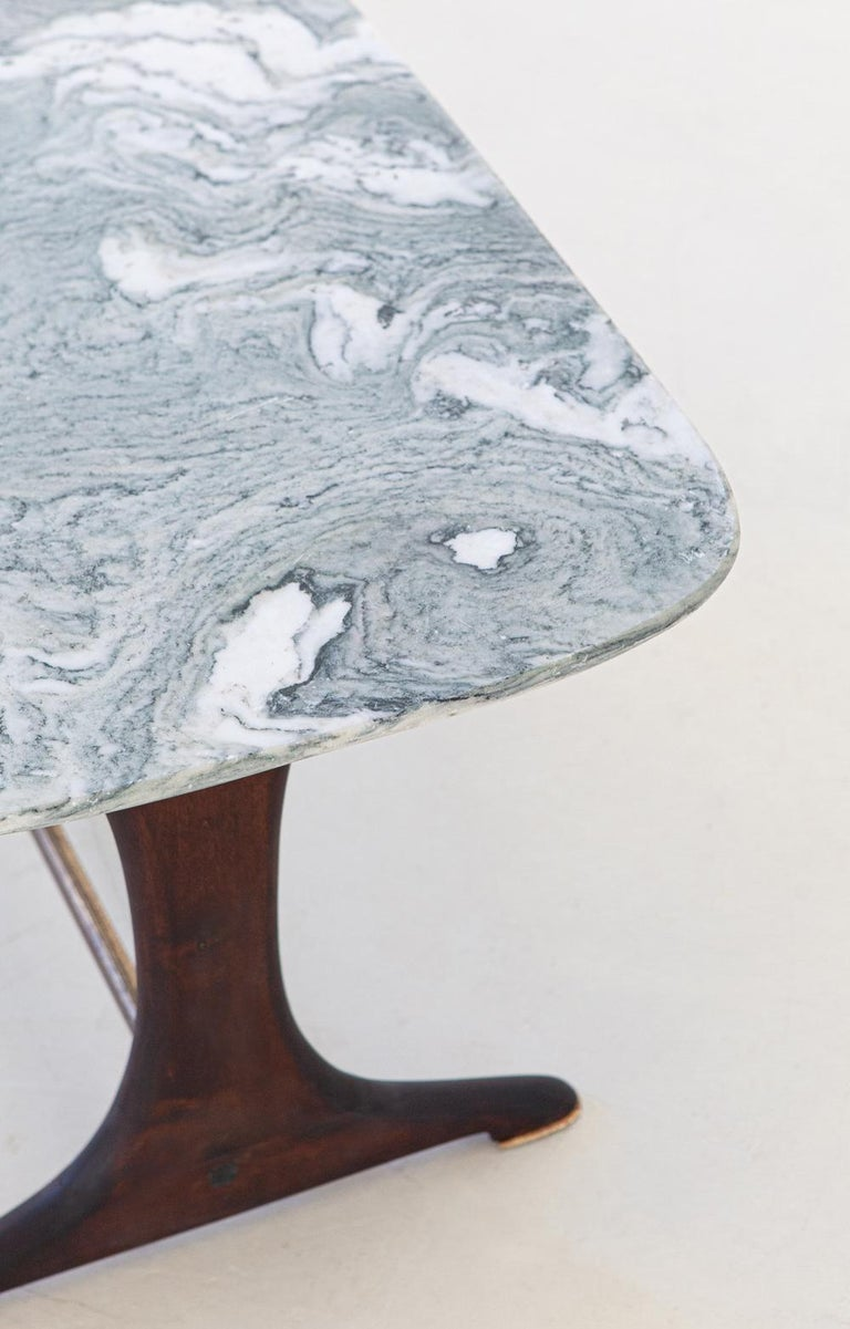 A coffee table, manufactured in Italy during the 1950s   Marble top, wooden legs and brass bar and feets  Very good conditions.