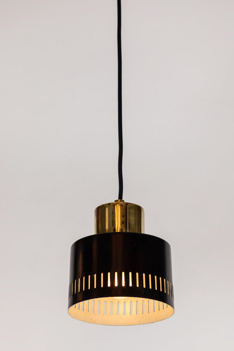Painted 1950s Italian Pendant in Black and Brass Attributed to Stilnovo For Sale