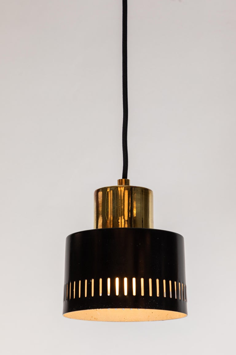 Mid-20th Century 1950s Italian Pendant in Black and Brass Attributed to Stilnovo For Sale