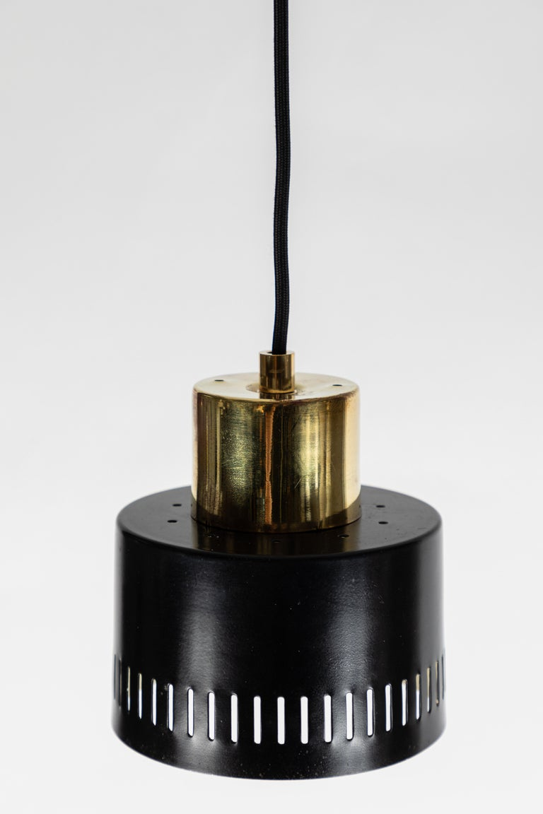 Metal 1950s Italian Pendant in Black and Brass Attributed to Stilnovo For Sale