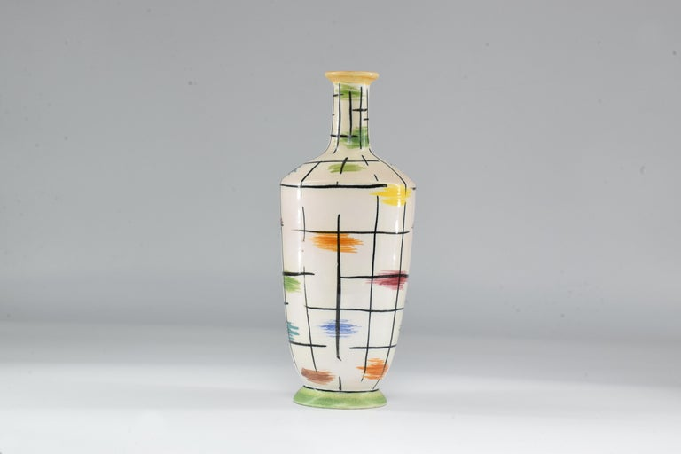This decorative ceramic vase is an original art piece by Italian designer Pucci Umbertide, known for mixing colors in a midcentury spirit with hand painted patterns. A great fit to lighten up any living area.