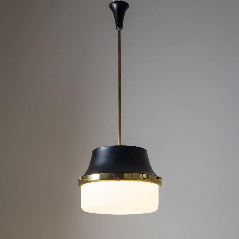Fine Italian modernist pendant or lantern from the 1950s. The large cased glass diffuser is satinated on the in- and outside for an extra soft light dispersion. On the top of the tapered lacquered aluminum shade is a satinated glass cover which