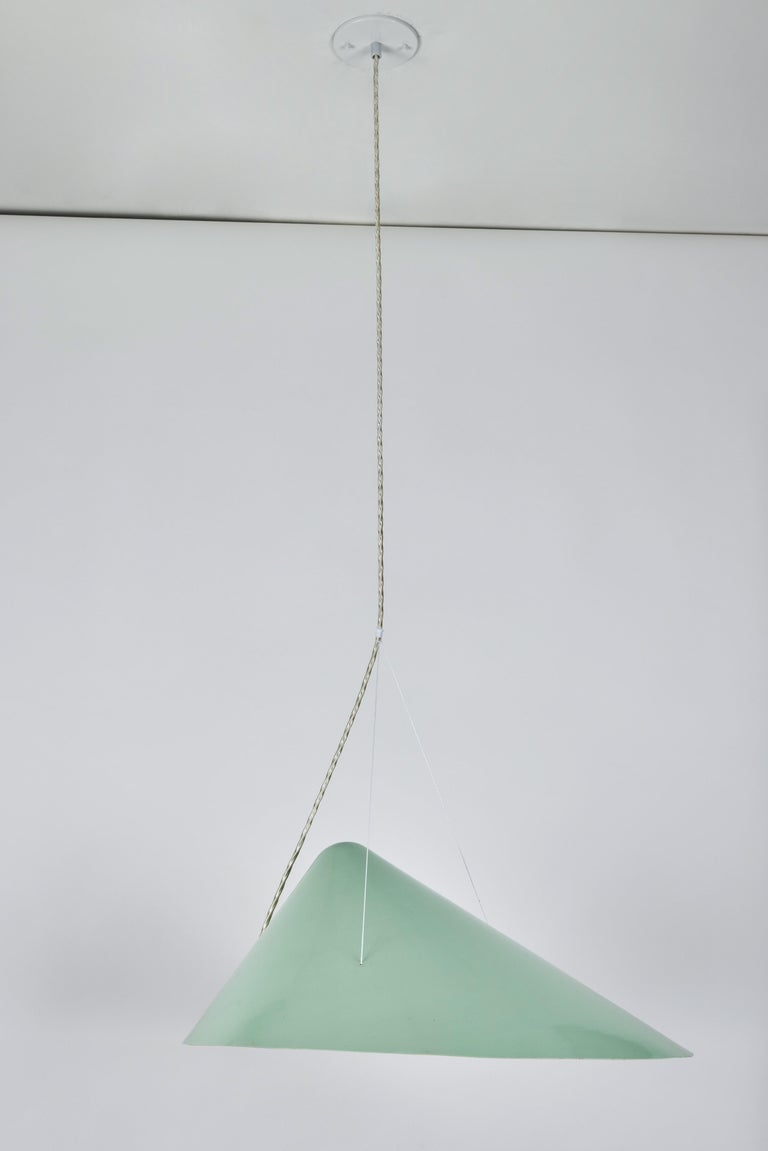 1950s Italian suspension lamp attributed to Ettore Sottsass for Arredoluce. An extremely sculptural design executed in green enameled metal, perspex and brass hardware. An unsigned highly refined lamp that shares numerous attributes to the iconic