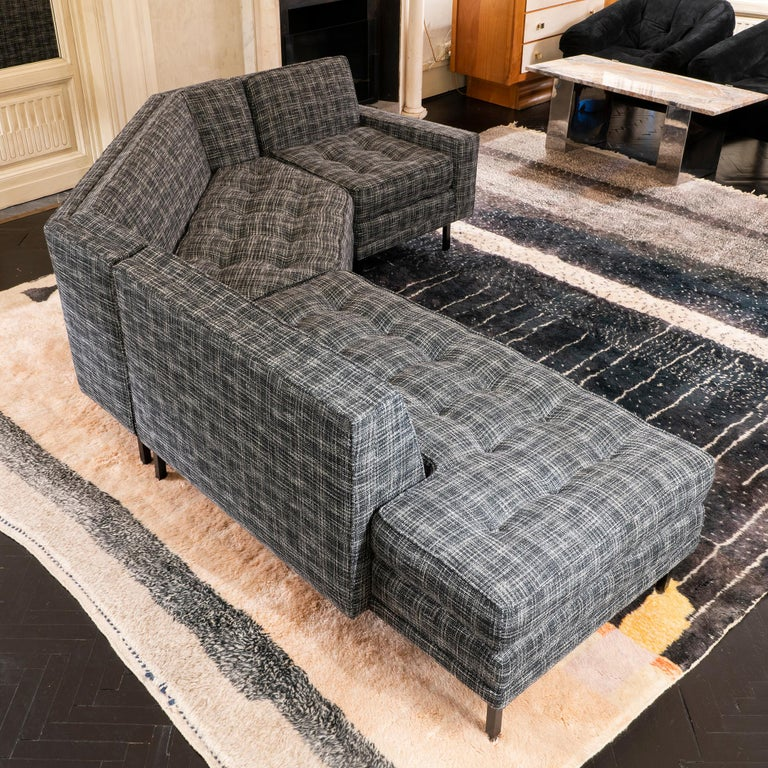 Three pieces modular sofa newly reupholstered in black and white bouclè fabric, black steel adjustable feets, perfect condition and vintage patina.