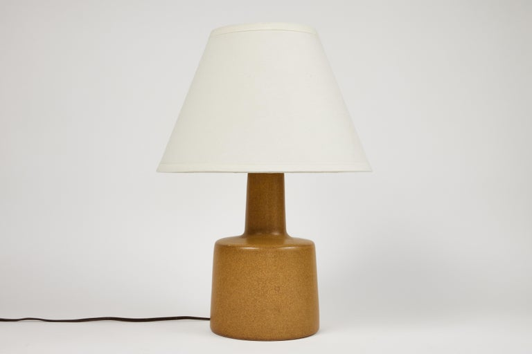 1950s Jane & Gordon Martz table lamp for Marshal Studios. Executed in ceramic with newer shades. Produced by Marshall Studios, Indianapolis, circa 1950s. An iconic example of midcentury Americana at its most refined. Signature in ceramic and both