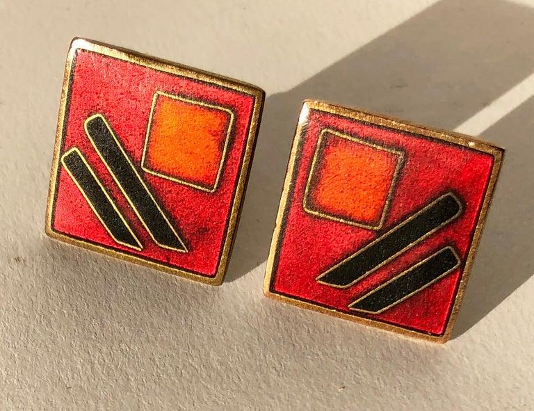 Pair of German modernist brass and enamel cufflinks designed by Karl Schibensky or Scholtz and Lammel, circa 1950s.  Dark red cufflinks measure .75