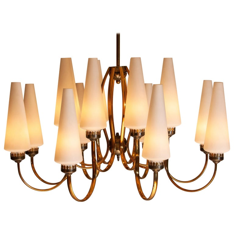 Exceptional big brass extra large chandelier withsixteen big Murano vases made by Stilnovo in the 1950s, Italy. The diameter of these big chandelier is 90 cm or 36 inches. The height of the Murano vases is 30 cm or 12 inches. The total height is