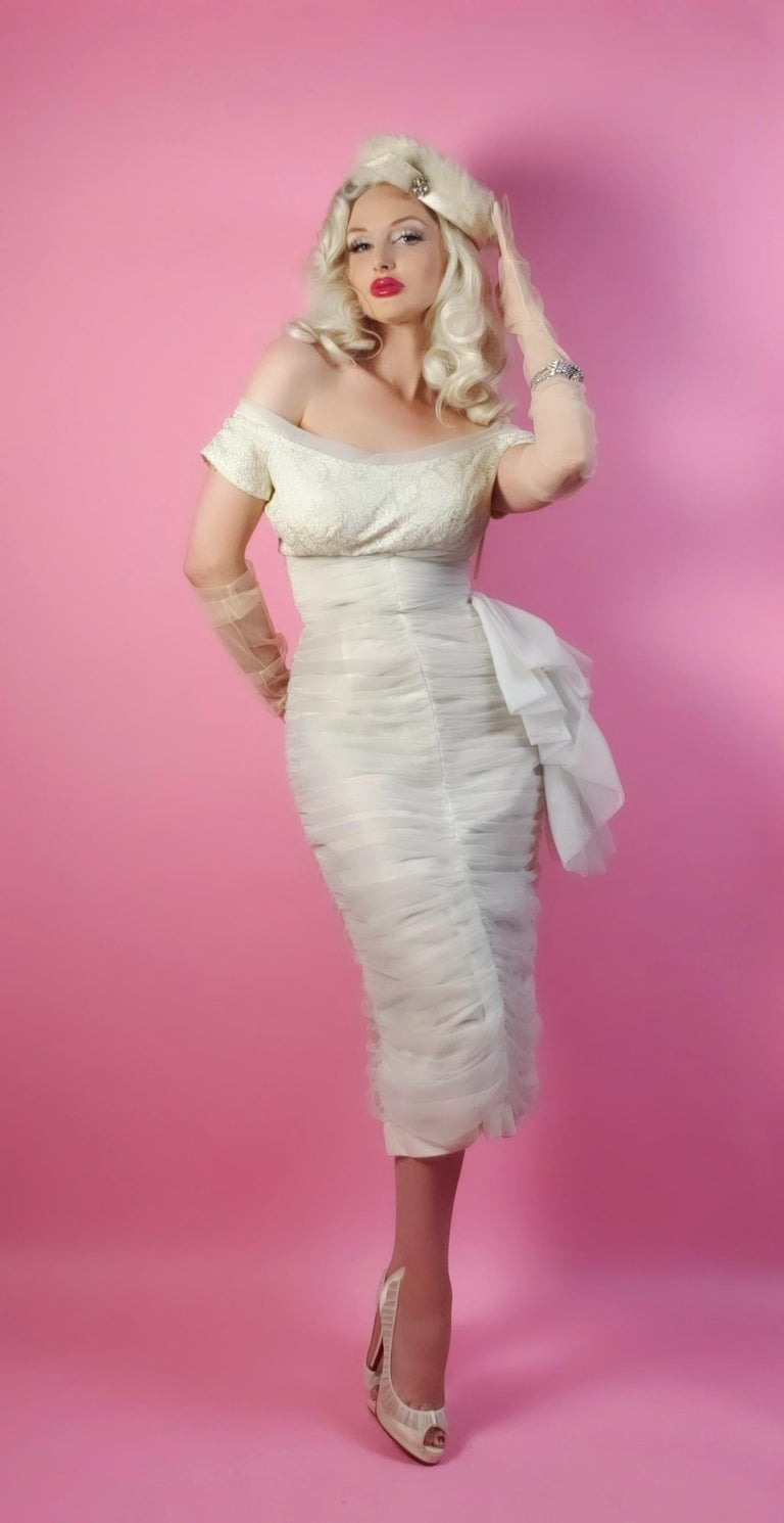 A seductive and highly stylized 1950's white chiffon cocktail dress by the famous Lilli Diamond. The silhouette is classic pin-up