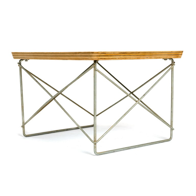 A 'LTR' (Low Table Rod) occasional table. Laminated plywood top on a metal strut base.