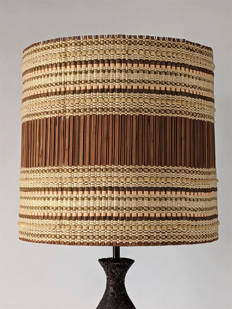 Maria Kipp chenille woven shade sitting on a well assorted US made chalkware table lamp by Quartite Creative Corp.   Shade measure 17 in. wide by 16 in. high.   Contain one E26 size socket rated at 100 watt.   Switch on socket.
