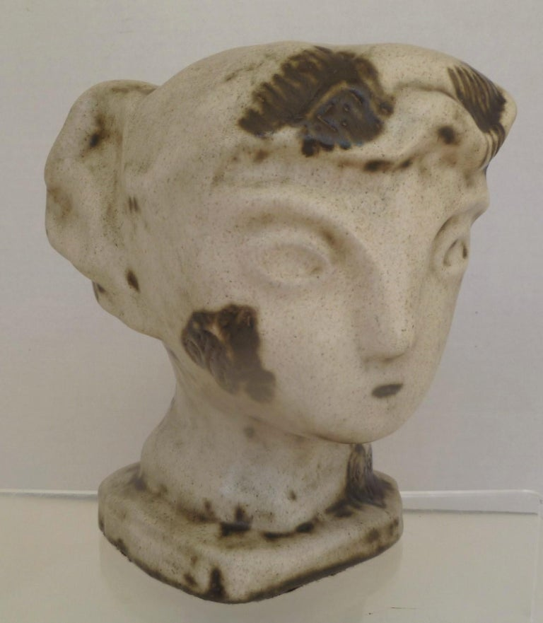 A rare and unique head sculpture from artist Marianna von Allesch. The depiction, a woman, brings to mind early Greek and Minoan forms. This head sculpture is approximately 8 inches tall and about 7 inches in diameter around the top of the head. A