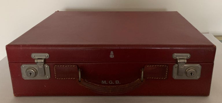 1950s red leather travel suitcase by Mark across. Ruby red smooth calf leather with tan fabric interior.