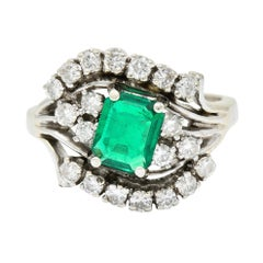 1950's Mid-Century 1.59 Carats Emerald Diamond 14 Karat White Gold Bypass Ring