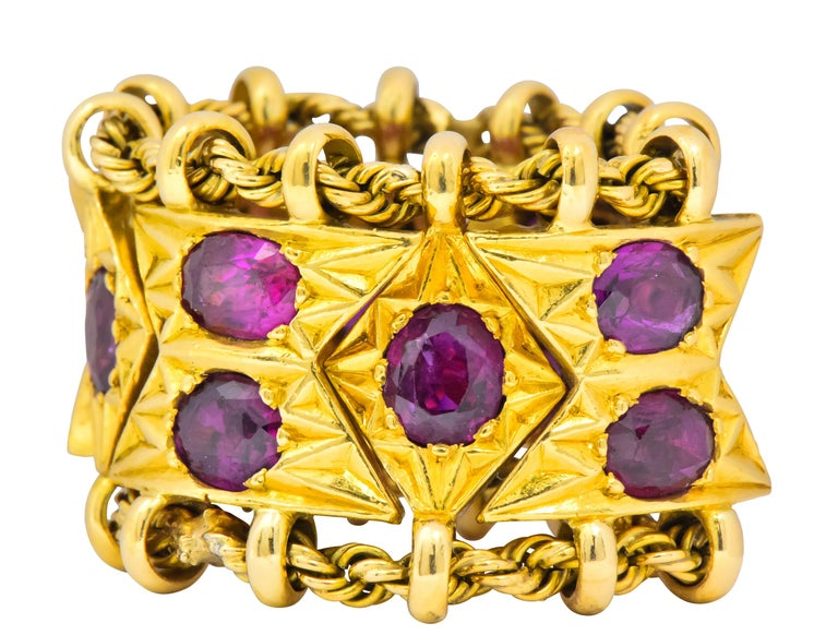 Really unique band style ring featuring dynamic chevron and navette shaped gold links each connected by a twisted gold rope chain; fully articulated  Bead set throughout by twelve well-matched oval cut rubies weighing in total 7.50 carats; very