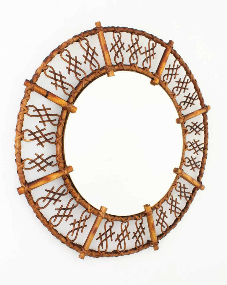 Unusual handcrafted rattan and bamboo mirror with chinoiserie accents on the frame. France, 1950s.