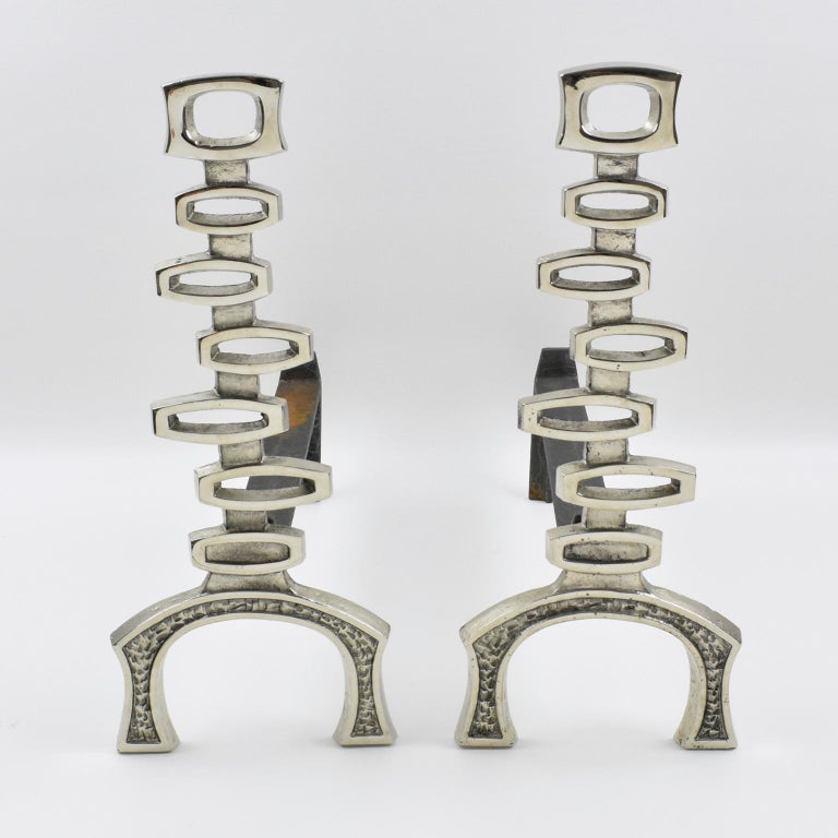 Lovely French Mid-Century modernist chromed bronze and wrought iron andirons. These andirons feature a pattern of stacked hollow cube detailing in textured chromed bronze. Elegant in finish and dynamic in form, those andirons form is a reference to