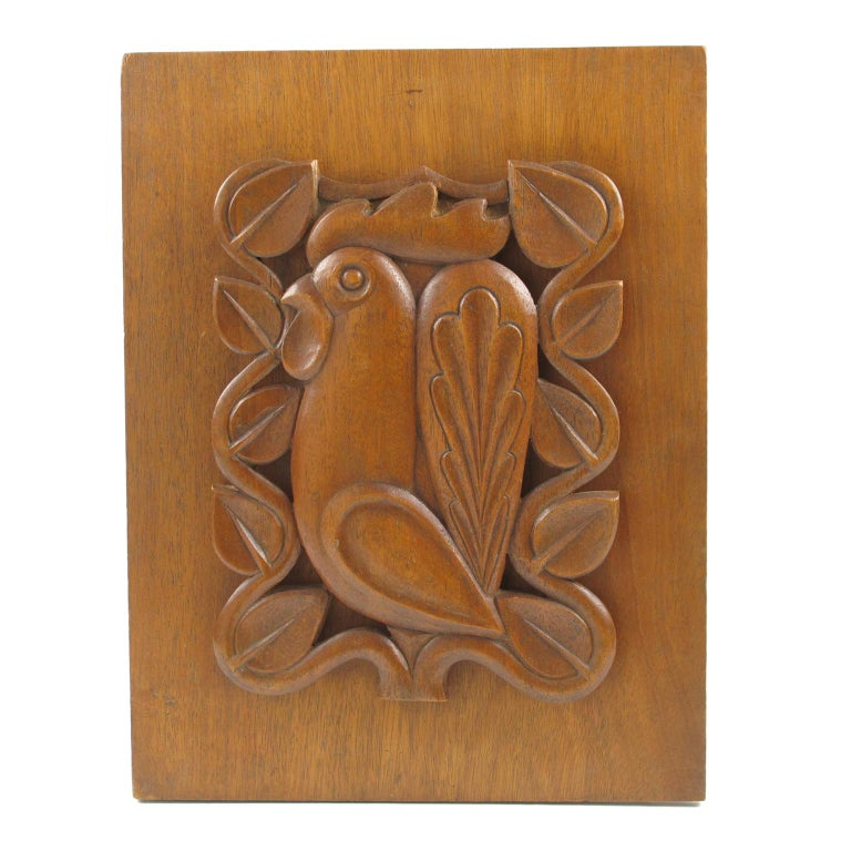 Superbly handcrafted French midcentury modernist wood wall art sculpture panel. Mounted on a plank of mahogany, the teak sculpted panel features a very stylized rooster carved and see-thru with beautiful typical 1950s modernist floral detailing all