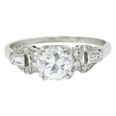 1950s Midcentury 0.89 Carat Diamond Platinum Buckle Engagement Ring
