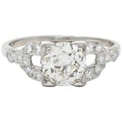 1950s Midcentury 1.25 Carat Diamond Platinum Buckle Engagement Ring GIA