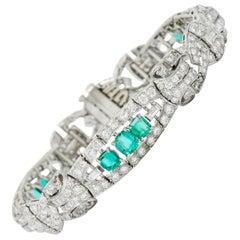 1950s Midcentury 9.55 Carat Emerald Diamond Platinum Scrolled Link Bracelet