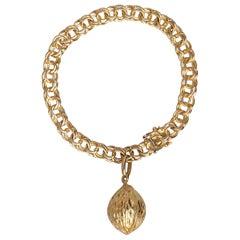 1950s Midcentury Classic Double Link 18-Karat Gold Charm Bracelet with Nut Charm