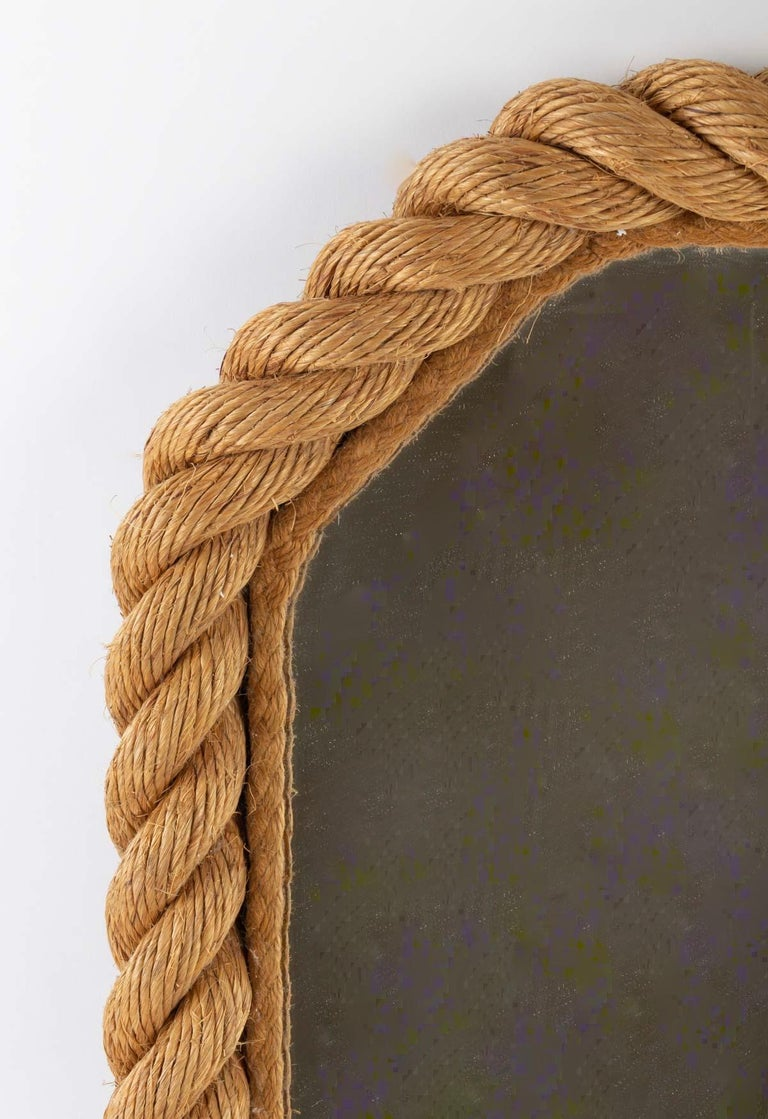Mirror of Adrien Audoux and Frida Minet  Elegant mirror with sloped corners, the frame is made of weaved rope.  Characteristic of the Audoux & Minet work.   Adrien Audoux and Frida Minet are known for their lights and furniture made of rope. Their